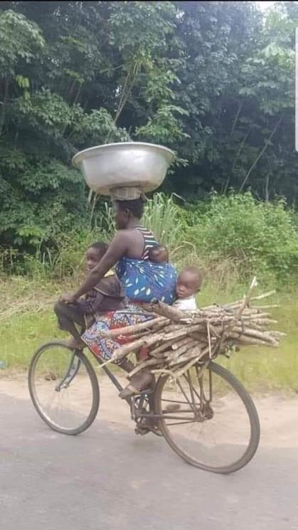 Multi tasking woman on bike